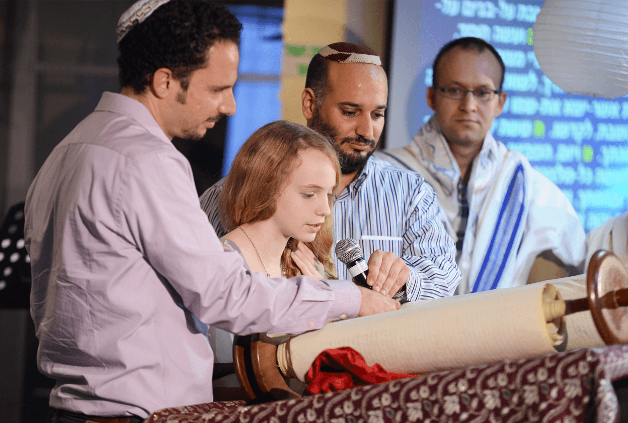 Tiferet Yeshua Bat Mitzvah celebration - reading from the Torah